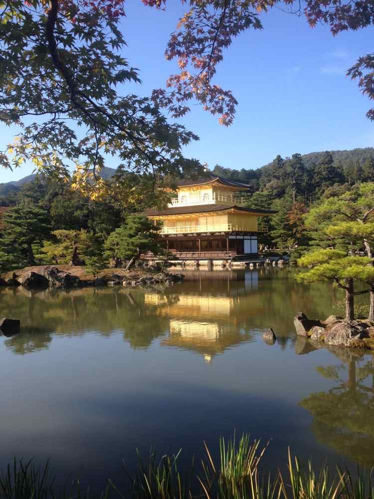 Kinkaku-ji, the Golden Pavilion. Each floor of the temple represents a different style of Japanese architecture.