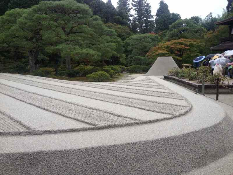 Hakusha, white sand, is used in zen temples signifying purity. No leaves or debris is allowed on the sand by cleaning it every day.