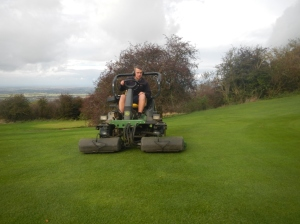 Mowing the aprons  (The area of slightly longer grass which wraps around the perimeter of the green)