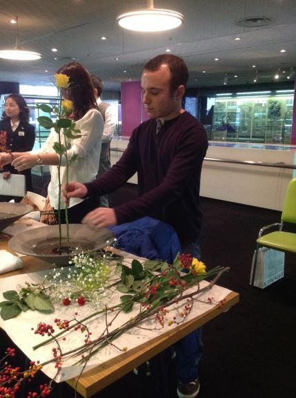 Ikebana is typically arranged while sitting or kneeling. But we both broke the rules that day and chose to stand.