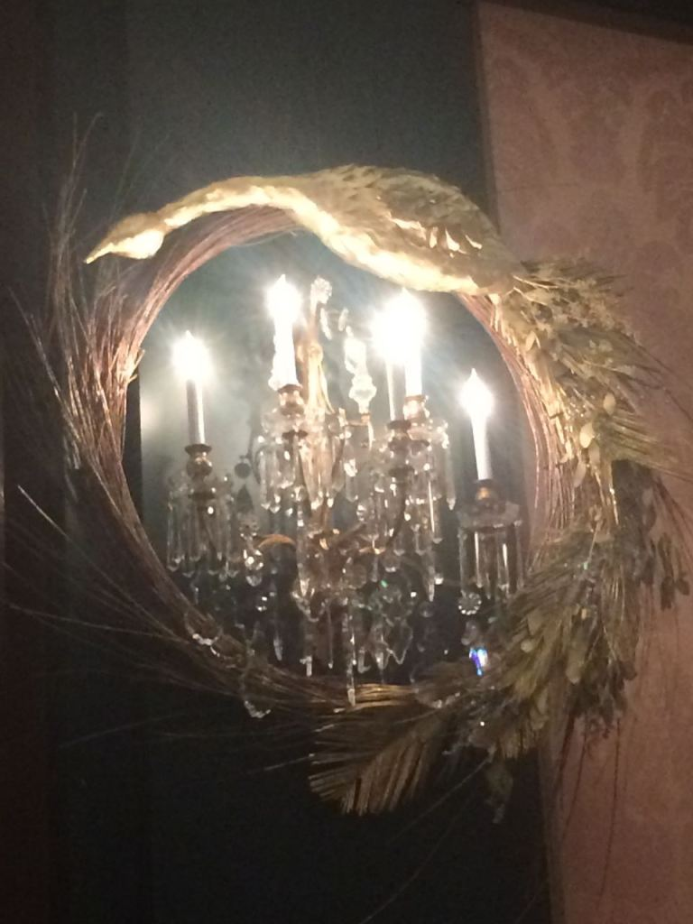 My favorite decoration for Longwood's display. Phoenix wreathes created with cycad leaves ecalaptus leaves, and salix branches were painted  gold and hang in the ballroom.