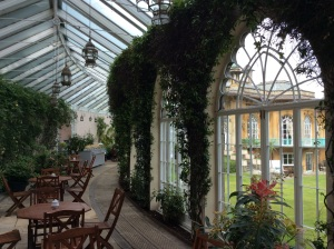 The verdant walls of the Orangerie Cafe.