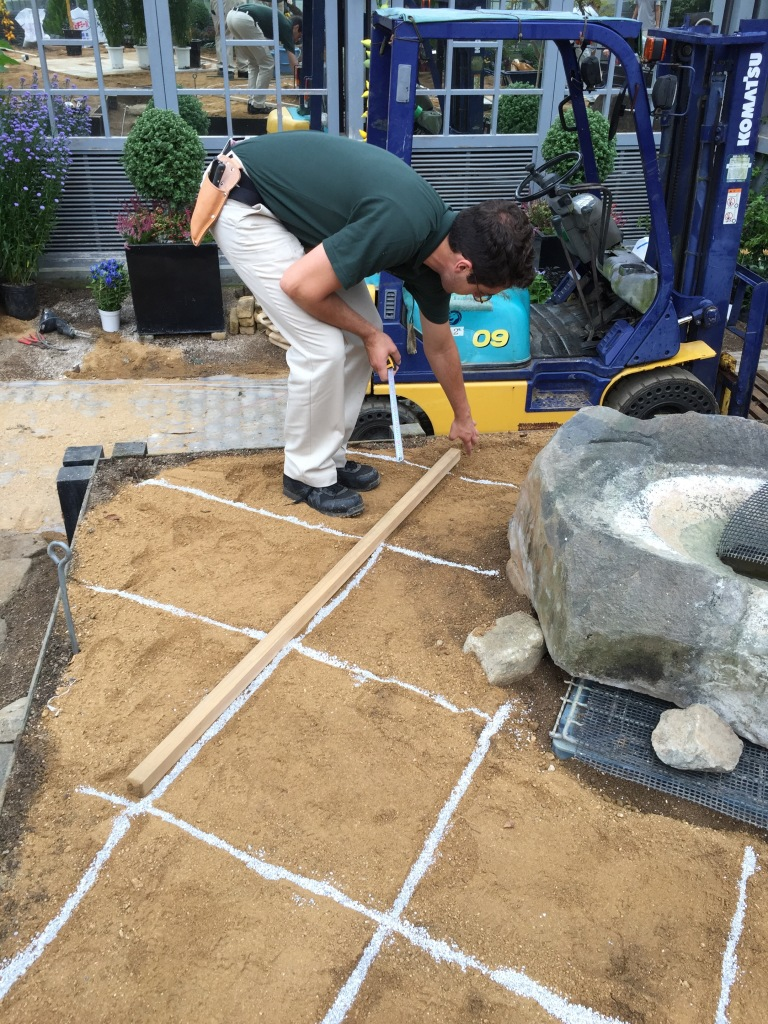 Laying out a grid in this corner of the display. This let us ensure the plantings remained the same orientation as the path