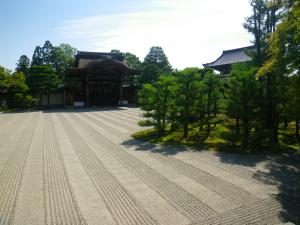 This vast gravel garden, within the Daitokuji Temple complex, is met by a grove of sculpted Cryptomeria, made to look like an ancient forest.